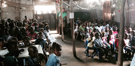 Children of Petite Anse in their community's church building.